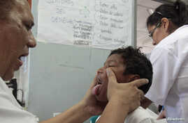 FILE - A dengue fever victim receives medical treatment at a health center in Managua, Oct. 31, 2013. Hemorrhagic dengue was responsible for 14 deaths in Nicaragua so far this year, with the number of cases confirmed at more than five thousand, accor