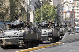 A Lebanese army convoy secures an area from clashes between the army and Sunni Muslim gunmen in Beirut after a night of tension following the funeral of an intelligence official killed by a car bomb, October 22, 2012.