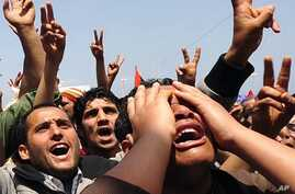 Mourners react during the funeral of rebel Ahmed al-Barasi, who they say was killed in Misrata by forces loyal to Libyan leader Muammar Gadhafi, in Benghazi, April 27, 2011