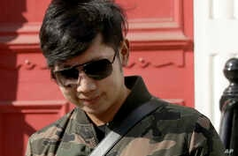 """FILE - Vorayuth """"Boss"""" Yoovidhya, whose grandfather co-founded energy drink company Red Bull, leaves a house in London, April 5, 2017."""
