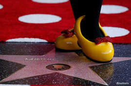 The character of Minnie Mouse poses on her star after it was unveiled on the Hollywood Walk of Fame in Los Angeles, California, Jan. 22, 2018.