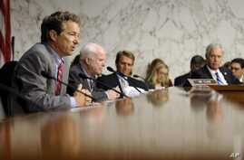 Senate Foreign Relations Committee members, from left, Sen. Rand Paul, Sen. John McCain, Sen. Jeff Flake, and Sen. Ron Johnson listen on Capitol Hill, Sept. 4, 2013, during the committee's hearing to consider the authorization for use of military for