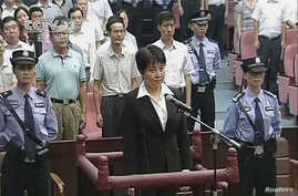 Gu Kailai (C), wife of ousted Chinese Communist Party Politburo member Bo Xilai, stands at the defendant's dock during a trial in the court room at Hefei Intermediate People's Court in this still image taken from video August 20, 2012.