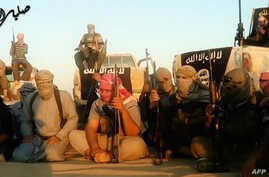 An image grab taken from a propaganda video uploaded on June 8, 2014, by the jihadist group the Islamic State of Iraq and the Levant [ISIL] allegedly shows ISIL militants gathered near Tikrit, Iraq.