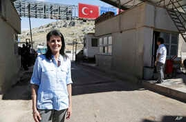 Nikki Haley, the U.S. Ambassador to the U.N., poses for a photo during a visit at the Reyhanli border crossing with Syria, near Hatay, southern Turkey, May 24, 2017.