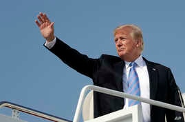 President Donald Trump waves as he boards Air Force One at Andrews Air Force Base, Maryland, July 3, 2018.