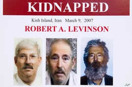 FILE- An FBI poster showing a composite image of former FBI agent Robert Levinson (right) of how he would look like now after five years in captivity, and an image (center) taken from the video, released by his kidnappers, and a picture before he wa...