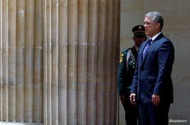 FILE PHOTO: Colombian President Ivan Duque awaits the arrival of Spain's Prime Minister Pedro Sanchez at an official ceremony at the presidential palace in Bogota, Colombia, Aug. 30, 2018.