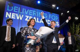New Zealand Prime Minister Bill English, front right, celebrates with his wife Mary English at a party function in Auckland, New Zealand, Sept. 23, 2017. Prime Minister Bill English's National Party won the most votes in New Zealand's general electio