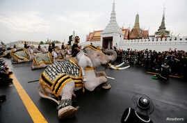 Ayuthaya elephants and mahouts pay their respects at the Royal Palace where Thailand's late king Bhumibol Adulyadej is lying in state, Nov. 8, 2016.