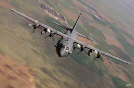 FILE - A U.S. AC-130 Spectre gunship like the one pictured, and U.S. A-10 warplanes launched from Turkey's Incirlik Air Base supported the Syrian Democratic Fores in the operation around al-Hawl, Syria..