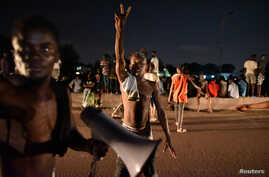 Supporters of Felix Tshisekedi, leader of the Congolese main opposition party, the Union for Democracy and Social Progress (UDPS) celebrate along the streets after the judges of the Constitutional Court confirmed Tshisekedi's victory in the president