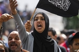 Pro-government supporters rally beside Salafist groups in Tunis April 9, 2013 to mark Martyr's Day.