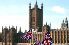 British Union flags fly in front of The Houses of Parliament in London, Jan. 22, 2019. British Prime Minister Theresa May launched a mission to resuscitate her rejected European Union Brexit divorce deal, setting out plans to get it approved by Parli