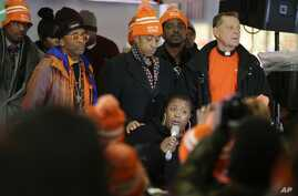 Cleo Pendleton, below, whose daughter was fatally shot by Chicago police in January, is comforted by the Rev. Al Sharpton as Spike Lee, second from left, listen to her speak during a rally for the prevention of gun violence, in New York, Dec. 1, 2015