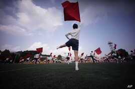 Students practice flag cheering routines at a Tokyo Korean junior and senior high school in Tokyo, Sept. 26, 2017. Many third- and fourth-generation descendants of Koreans brought to Japan during the imperialist years before and during World War II r