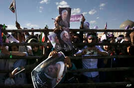 Supporters of Iranian President Hassan Rouhani in the May 19 presidential election attend his campaign rally, in Isfahan, Iran, Sunday, May 14, 2017.