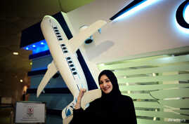 Dalia Yashar, one of the first Saudi students who registered to become a commercial pilot, stands in front of the registration center of CAE Oxford ATC at King Fahd International Airport in Dammam, Saudi Arabia, July 15, 2018.