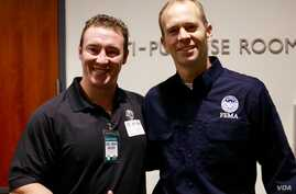 Carl Higbie (left) and FEMA Administrator Brock Long pose together after an October 2017 meeting to discuss wildfires in California.