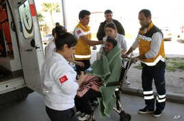 Medics take care of a rescued migrant at a local hospital in the Aegean resort of Didim, Turkey, March 6, 2016. Turkey's state-run news agency says 18 migrants have drowned off the Turkish coast while trying to reach Greece.
