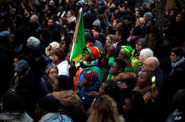 Protestors attend a demonstration against slavery in Libya outside the Libyan Embassy in Paris, Nov. 24, 2017.
