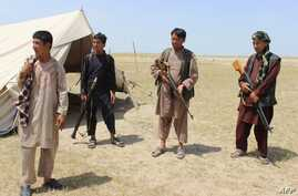 Members of an Afghan militia look on during fighting between Taliban militants and Afghan security forces near the Qala-e-Zal district in Kunduz province, May 7, 2017.