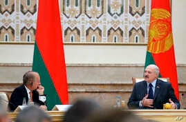 Belarusian President Alexander Lukashenko, right, delivers a speech as Chairman of the Munich Security Conference Wolfgang Ischinger, left, looks on during the Munich Security Conference Core Group meeting in Minsk, Oct. 31, 2018.