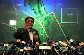 Malaysia's Department of Civil Aviation's Director General Azharuddin Abdul Rahman briefs reporters on search and recovery efforts within existing and new areas for missing Malaysia Airlines plane during a press conference, Monday, March 10, 2014 in