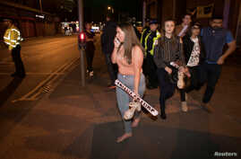 Concert goers react after fleeing the Manchester Arena in northern England where U.S. singer Ariana Grande had been performing in Manchester, Britain, May 22, 2017.