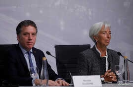 International Monetary Fund Managing Director Christine Lagarde and Argentina's Treasury Minister Nicolas Dujovne attend a news conference in Buenos Aires, Argentina, July 21, 2018.
