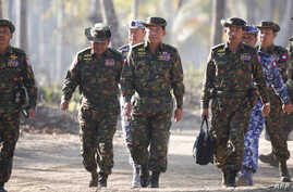 Myanmar's army chief, Senior General Min Aung Hlaing (C), is seen arriving with senior military officials to observe military exercises in Myanmar's Ayeyarwaddy Delta region, February 3, 2018.