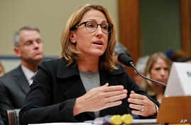 FILE - Mylan CEO Heather Bresch testifies on September 16, 2016, before Congress over the cost of her company's EpiPens. Lawmakers are outraged at high prescription drug costs, without acknowledging the role Congress may have played.