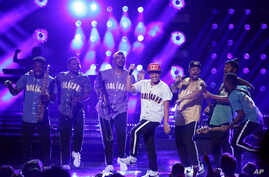 "FILE - Bruno Mars performs ""Perm"" at the BET Awards at the Microsoft Theater on Sunday, June 25, 2017, in Los Angeles."