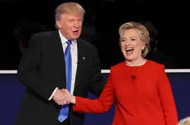 Republican presidential nominee Donald Trump and Democratic presidential nominee Hillary Clinton shake hands after the presidential debate at Hofstra University in Hempstead, N.Y., Sept. 26, 2016.