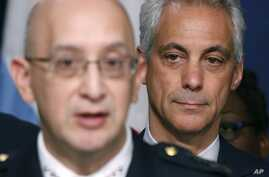 Chicago Mayor Rahm Emanuel, right, listens to Police Superintendent John Escalante during a news conference about new police procedures on Dec. 30, 2015, in Chicago.