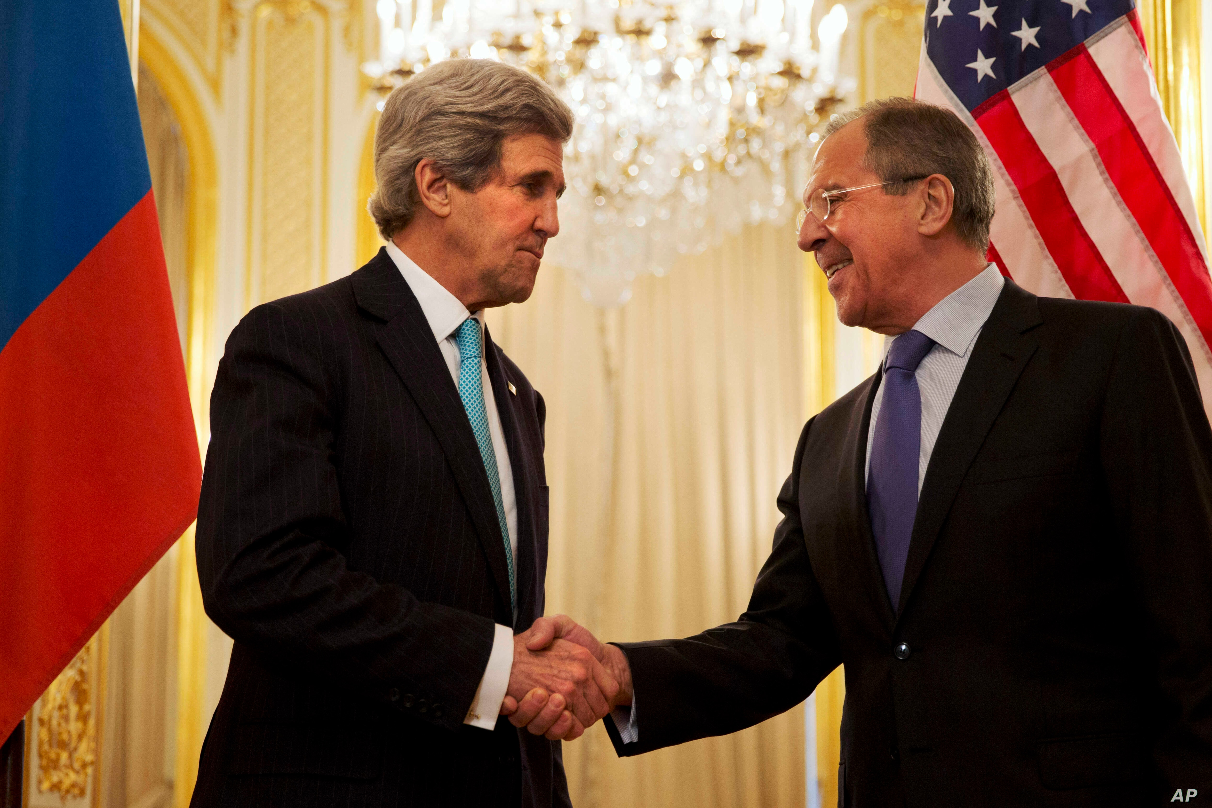 U.S. Secretary of State John Kerry, left, shakes hands with Russian Foreign Minister Sergey Lavrov before the start of their meeting at the Russian Ambassador's residence about the situation in Ukraine, in Paris, March 30, 2014.