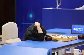 Chinese Go player Ke Jie reacts during his second match against Google's artificial intelligence program AlphaGo at the Future of Go Summit in Wuzhen, Zhejiang province, China, May 25, 2017.