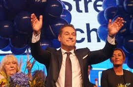 Hans-Christian Strache, leader of the strongly eurosceptic Austrian Freedom Party, waves to his supporters in Vienna, Austria, Sunday, Oct. 15, 2017, after the closing of the polling stations for the Austrian national elections.