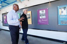 Smithsonian Curator Dr. Aaron Bryant, gives a personal tour to Ben & Jerry's Co-Founder Jerry Greenfield, at the opening of an exhibit at the ice cream factory on June 22, 2018, in Waterbury, Vt. (Lori Duff/AP Images for Ben & Jerry's)