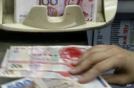 China's Currency Valuation Creates Focal Point Debate