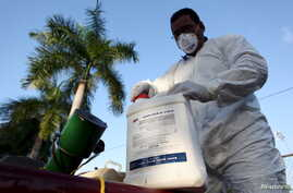FILE - A health worker prepares insecticide before fumigating a neighborhood in San Juan, Puerto Rico, Jan. 27, 2016. Mosquitoes carry the Zika virus, which has been linked to the birth defect microcephaly.