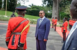 Ethiopia's new Prime Minister Abiy Ahmed, 42, who was installed in April, inspects the honor guard as he arrives to meet for bilateral talks with Uganda's President Yoweri Museveni at State House in Entebbe, Uganda, June 8, 2018.