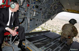 FILE - U.S. Defense Secretary James Mattis looks out over Kabul as he arrives via helicopter at Resolute Support headquarters in Kabul, Afghanistan, April 24, 2017. Mattis is headed to Iraq to meet with Iraqi government leaders and U.S. commanders.