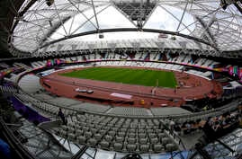 Workers continue preparations ahead of the start of the World Athletics Championships at the London Stadium, in the Queen Elizabeth Olympic Park in London, Aug. 1, 2017. The championships begin on Friday.