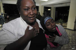 Relatives cry for their loved one as he is brought into hospital after an explosion, Al-Shabab sympathizers are suspected in many of the blast attacks, December 7, 2012..