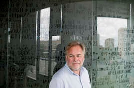 Eugene Kaspersky, Russian antivirus programs developer and chief executive of Russia's Kaspersky Lab, stands in front of a window decorated with programming code's symbols at his company's headquarters in Moscow, July 1, 2017.