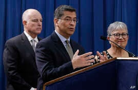 California Attorney General Xavier Becerra, joined by Gov. Jerry Brown and California Air Resources Board Chair Mary Nichols, discusses a lawsuit filed by 17 states and the District of Columbia over the Trump administration's plans to scrap vehicle e