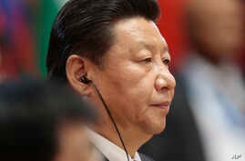 Chinese President Xi Jinping listens during the BRICS summit in Ufa, Russia, July 9, 2015.