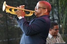Terence Blanchard, foreground, and Herbie Hancock perform at a sunrise concert marking International Jazz Day in New Orleans, April 30, 2012.