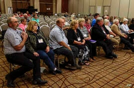 Landowners who object to the Keystone XL pipeline being built through their property sit in the front row as they listen to testimony before the Nebraska Public Service Commission in Lincoln, Nebraska, Aug. 7, 2017.